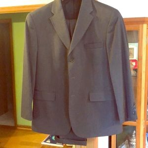 Men's grey haggar black label suit.